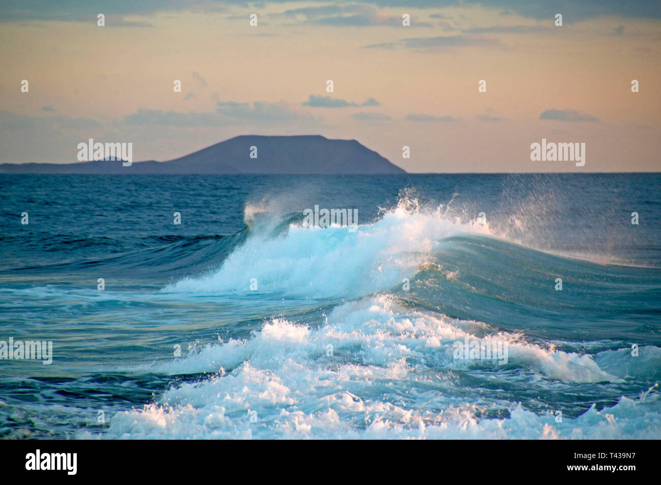 Sea surf in the evening at Playa Blanca in Lanzarote, view of Fuerteventura, Canary Islands Stock Photo