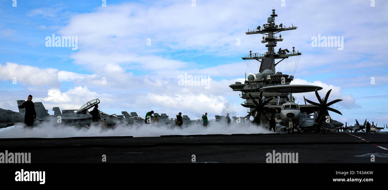 190411-N-NF912-0263 ATLANTIC OCEAN (April 11, 2019) Sailors perform a no-load evolution on a catapult on the flight deck of the Nimitz-class aircraft carrier USS Abraham Lincoln (CVN 72). Abraham Lincoln is underway as part of the Abraham Lincoln Carrier Strike Group deployment in support of maritime security cooperation efforts in the U.S. 5th, 6th and 7th Fleet areas of responsibility. With Abraham Lincoln as the flagship, deployed strike group assets include staffs, ships and aircraft of Carrier Strike Group (CSG) 12, Destroyer Squadron (DESRON) 2, the guided-missile cruiser USS Leyte Gulf  - Stock Image