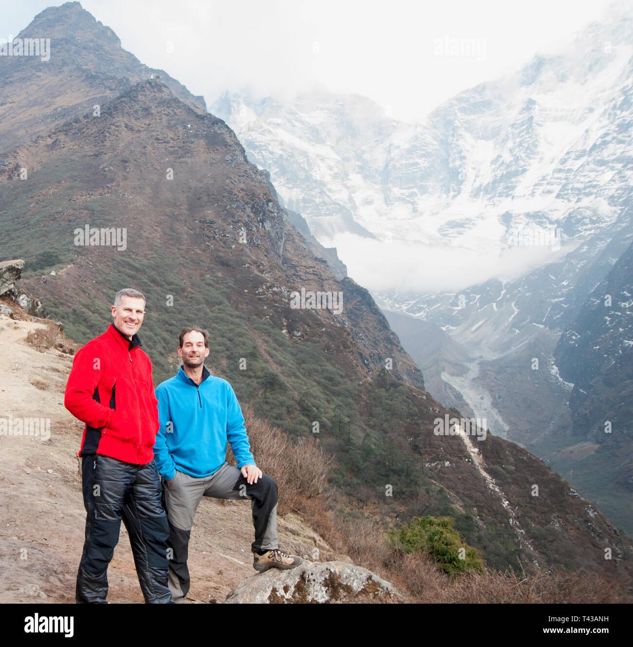 Men posing on mountain - Stock Image
