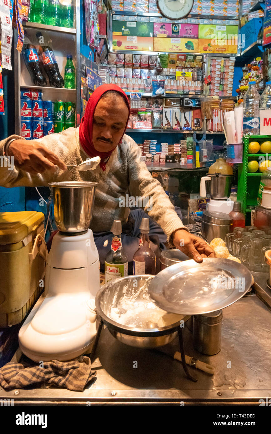 Vertical view of lassi being made at a juice stall in Kolkata aka Calcutta, India. - Stock Image