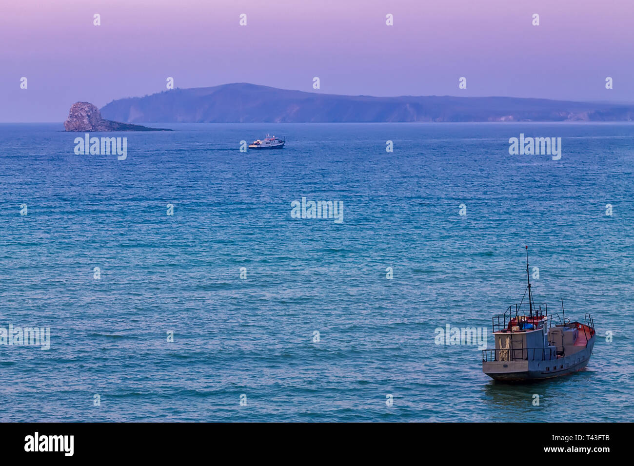 Ship Sails On A Background Of Purple Sunset Sky On The Waves Of Lake Baikal From Olkhon Stock Photo Alamy