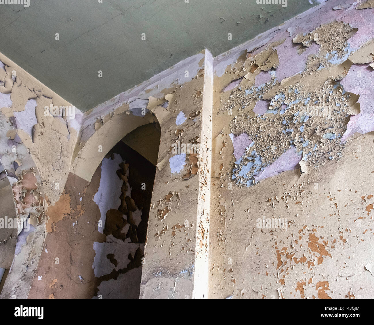 Weathered old wall of Building with layers of peeling paint - Stock Image