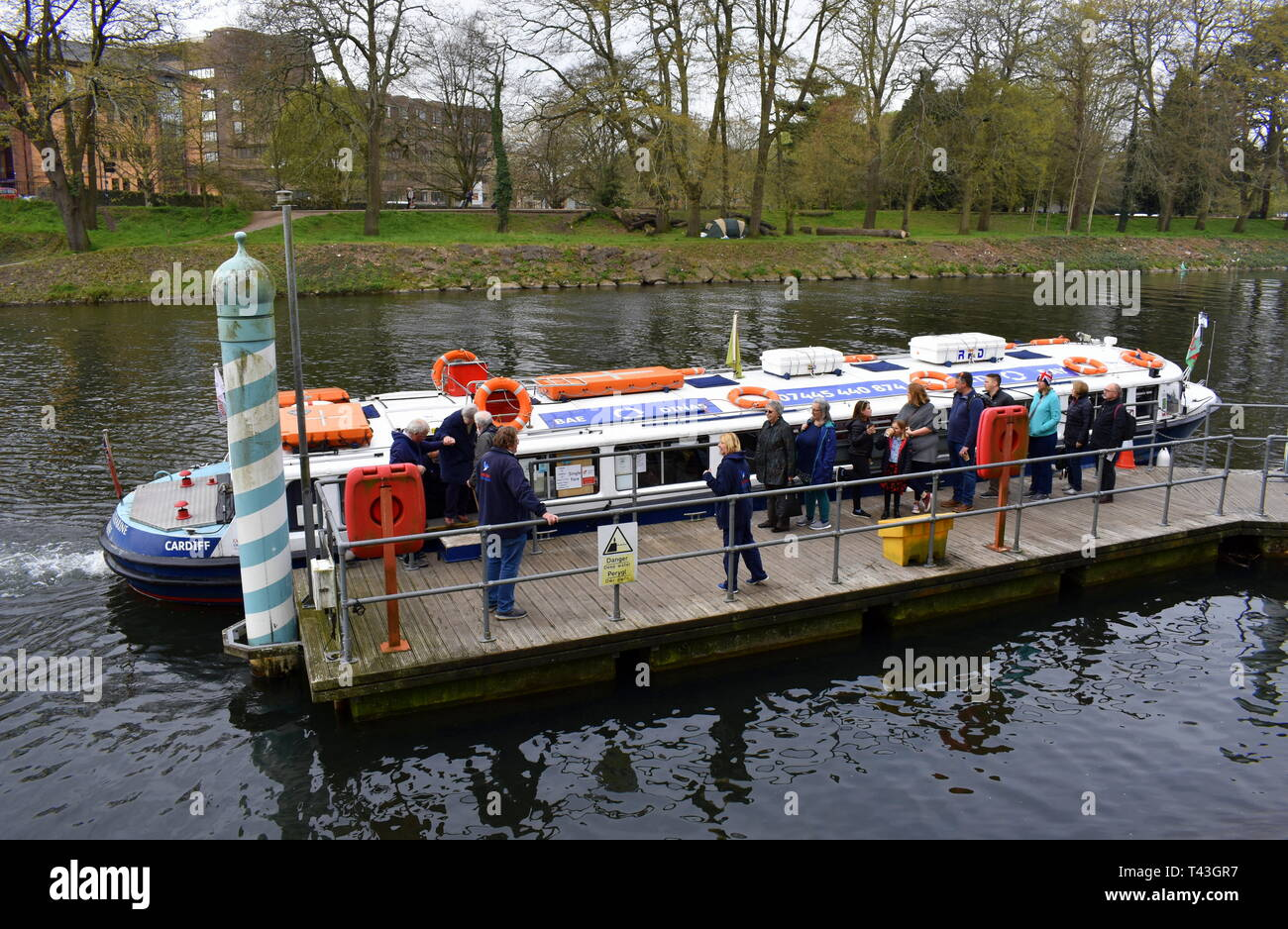 People waiting to embark the Princess Katherine water taxi from Cardiff city centre to Cardiff Bay - Stock Image