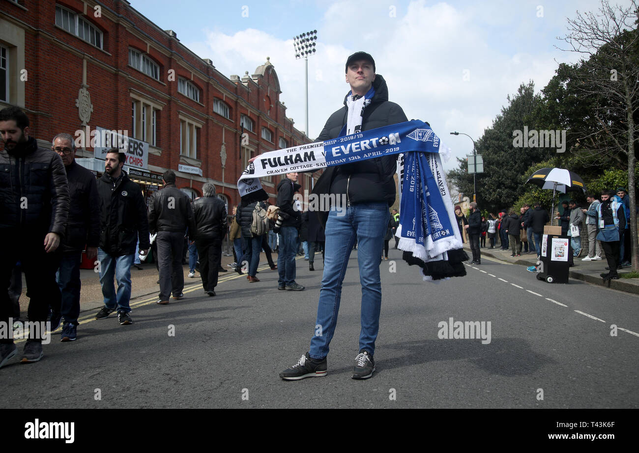 Scarves on sale outside the ground before the Premier League match at Craven Cottage, London. - Stock Image