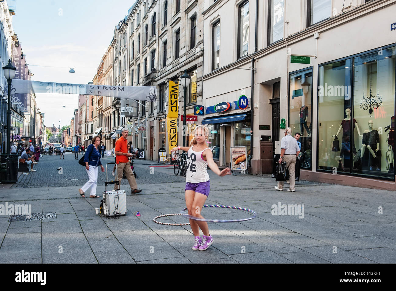 Norway, Oslo. August 1, 2013. Girl gymnast dancing in the square with Oslo. Additional income for the student. Editorial. - Stock Image
