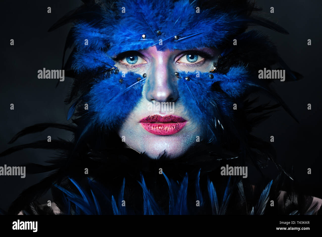 Bird Halloween Makeup.Woman With Halloween Makeup Model Face Bird Character With Blue And Black Feathers Stock Photo Alamy