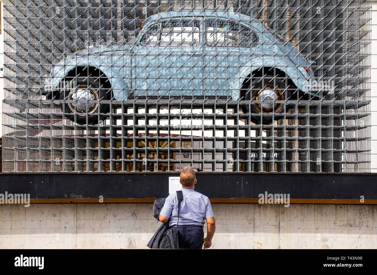 Karlsruhe, artwork by Georg Seibert, The Beetle a German wonder, VW Beetle in a shell made of galvanized structural steel, part of the ZKM Museum, Kar - Stock Image