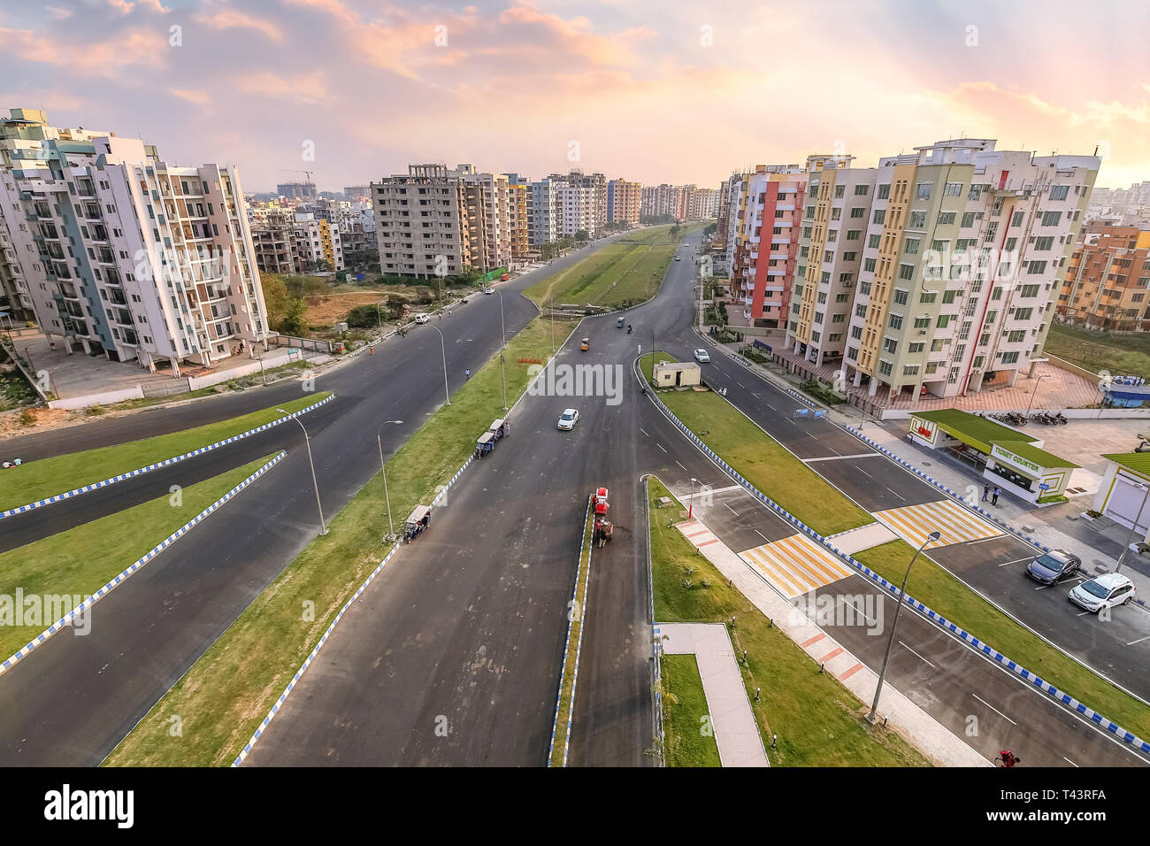 City residential building apartments with city roads in aerial view at sunset. Photograph shot at Newtown Rajarhat area of Kolkata, India - Stock Image