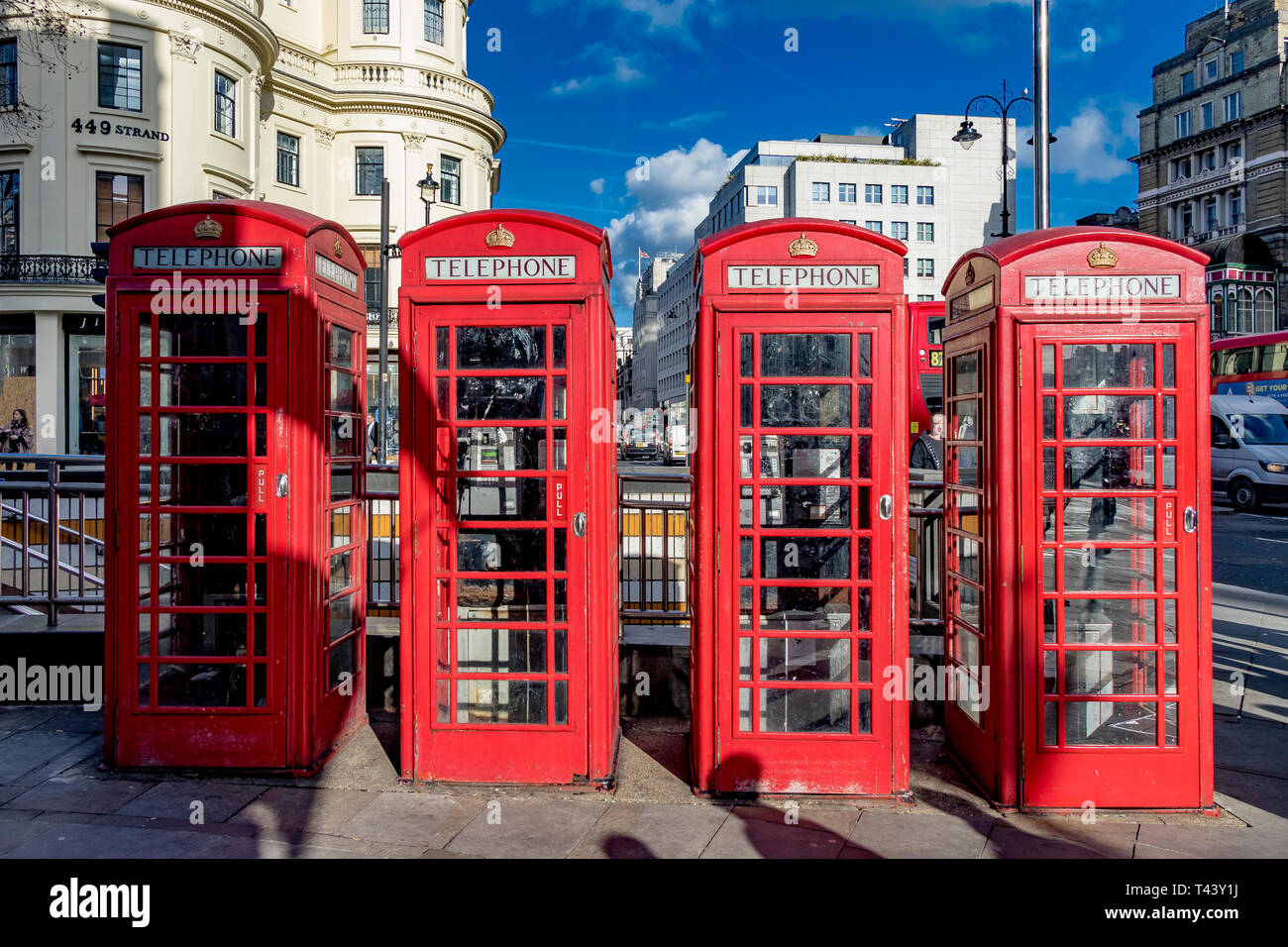 A row of Red public telephone boxes on The Strand at The junction with Duncannon St ,London WC2 - Stock Image