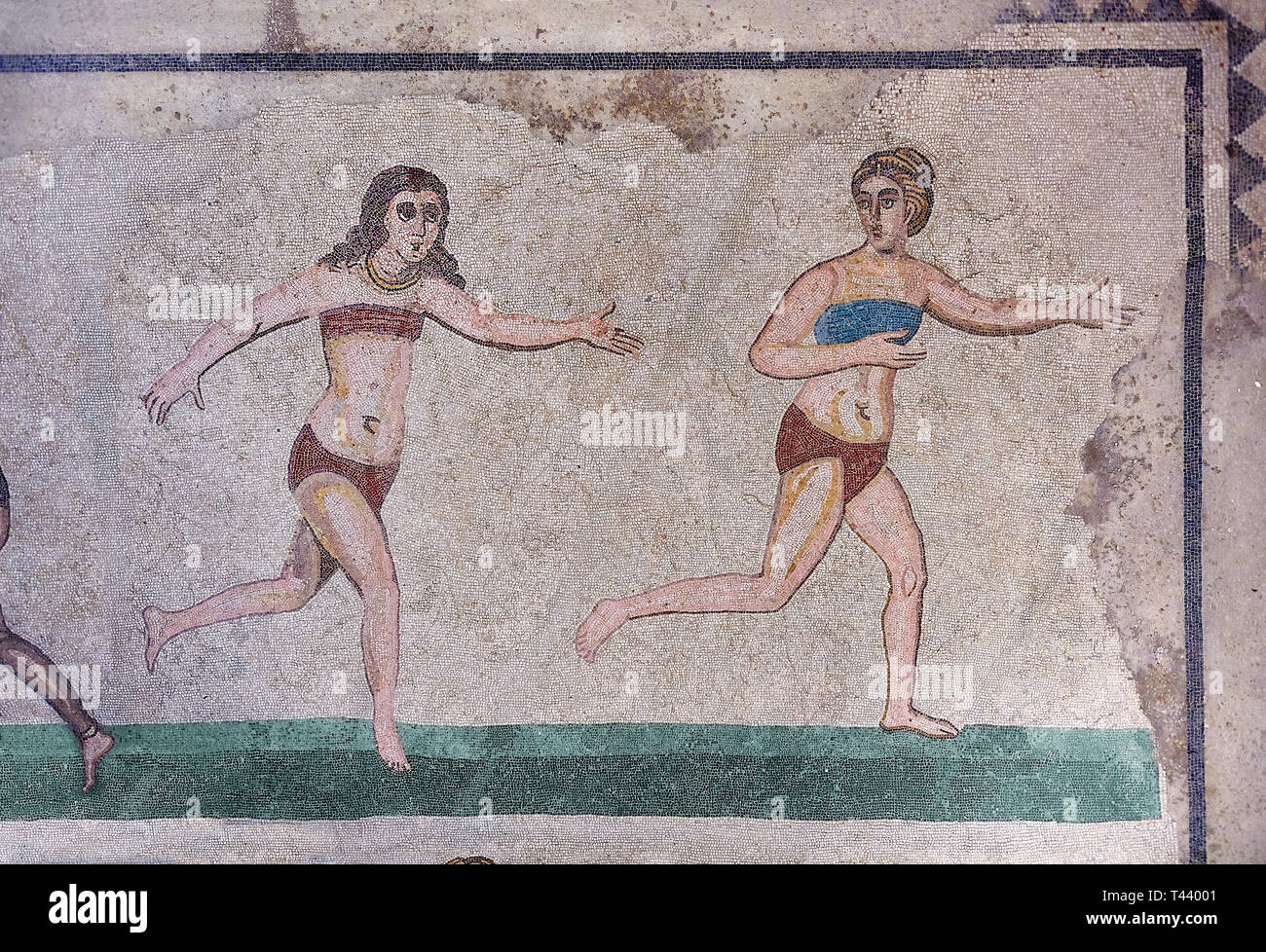 Mosaic detail fron the Room of the Ten Bikini Girls, room no 30, from the Ambulatory of The Great Hunt, room no 28,  at the Villa Romana del Casale wh - Stock Image
