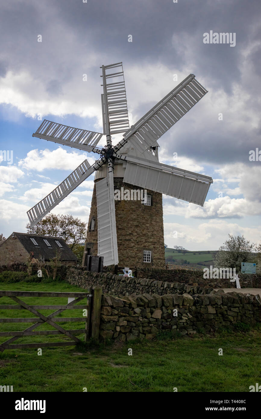 Historic Six Sailed Grade II Stone Tower Working Windmill in Heage Derbyshire.England - Stock Image