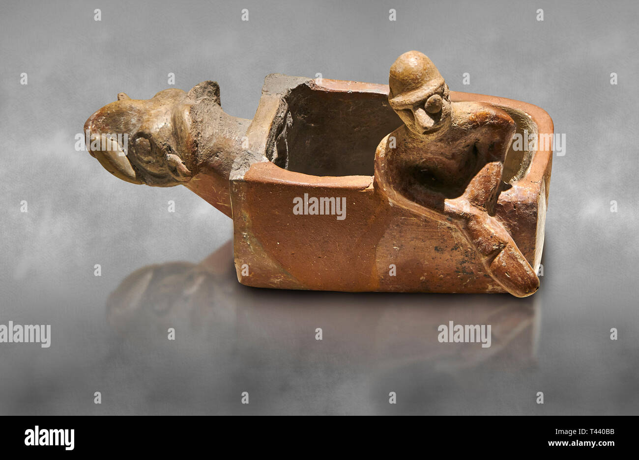 Assyrian Trader Colony Bronze Age terracotta sandal shaped ritual vessed. This cult pot is boat shaped with an animal head at the front. Inside the ve Stock Photo