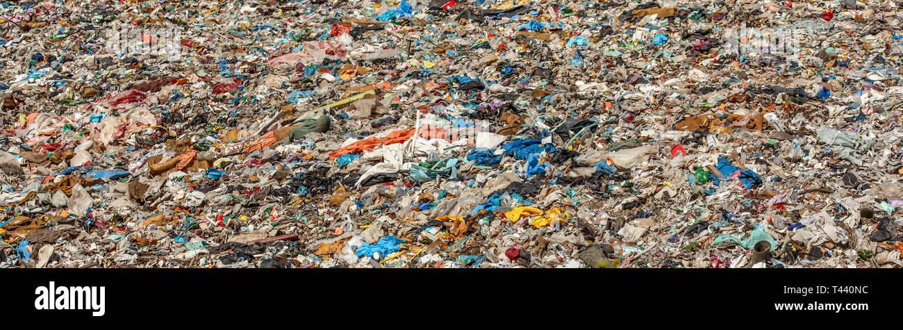 Various garbage on landfill site baner (no logos / trademarks visible on dump stuff) - Stock Image