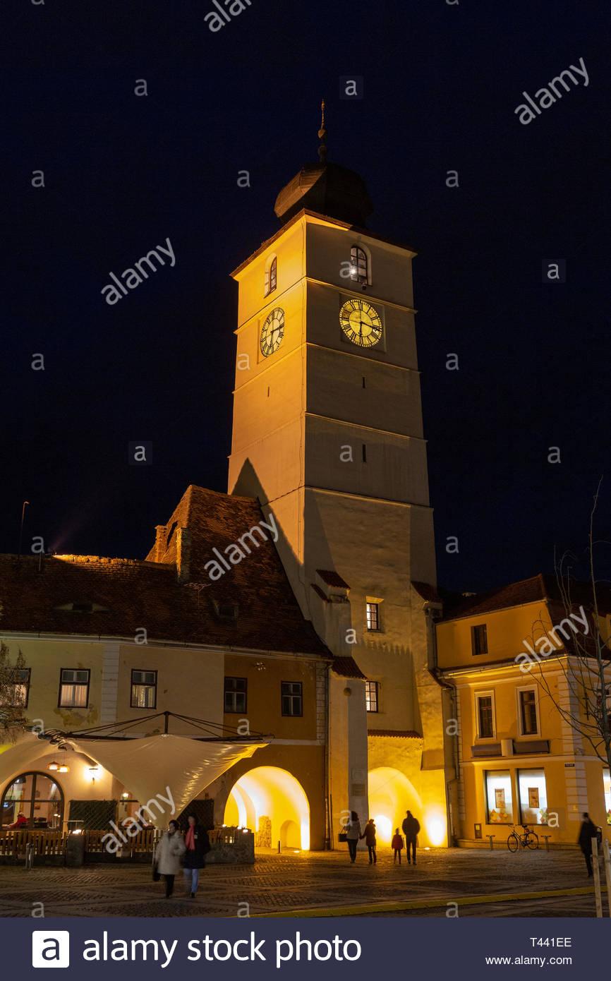 The Clock Tower of Cisnădiei Gate at Night - Sibiu, Romania - Stock Image