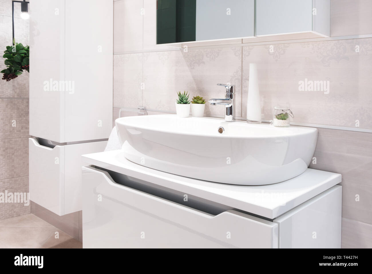Luxury Faucet Mixer On A Round Bowl White Sink In A Beautiful Beige Gray Bathroom Stock Photo Alamy