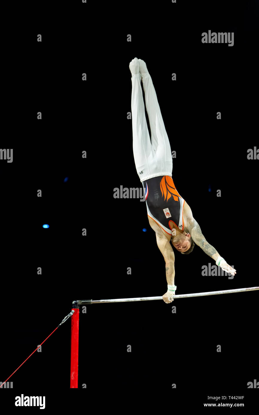 Birmingham, England, UK. 23 March, 2019. The Netherlands' Bart Deurloo in action during the men's horizontal bar competition, during the 2019 Gymnasti - Stock Image