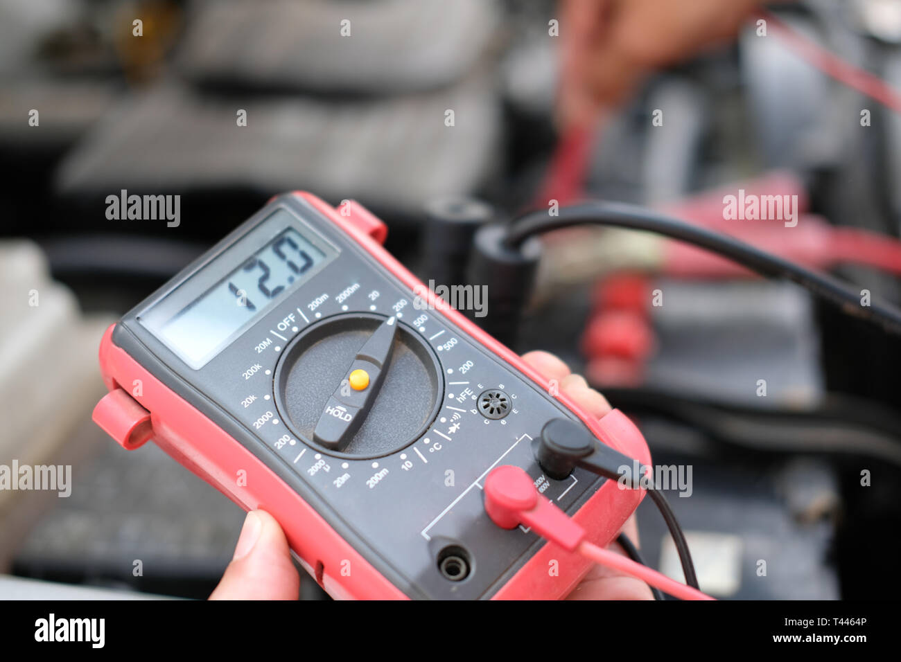 Auto Mechanic Check Car Battery Voltage By Voltmeter Multimeter At