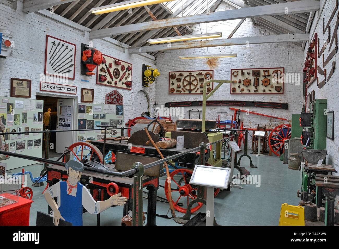Display of agricultural machinery at the Long Shop Museum, Leiston, Suffolk, UK - they used to make machinery in the factory Stock Photo