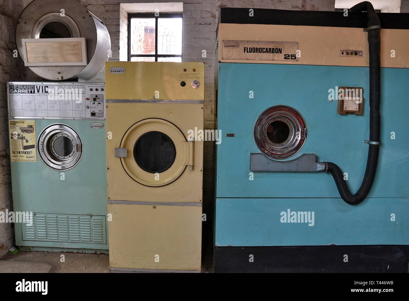 Dry cleaning machines at the Long Shop Museum, Leiston, Suffolk, UK. They were made in the factory at one time. - Stock Image