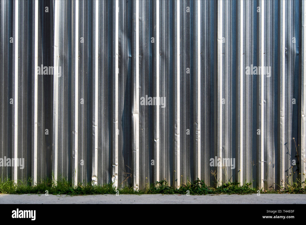 The construction site border fance enclosed high and strong by corrugate metal sheet - Stock Image