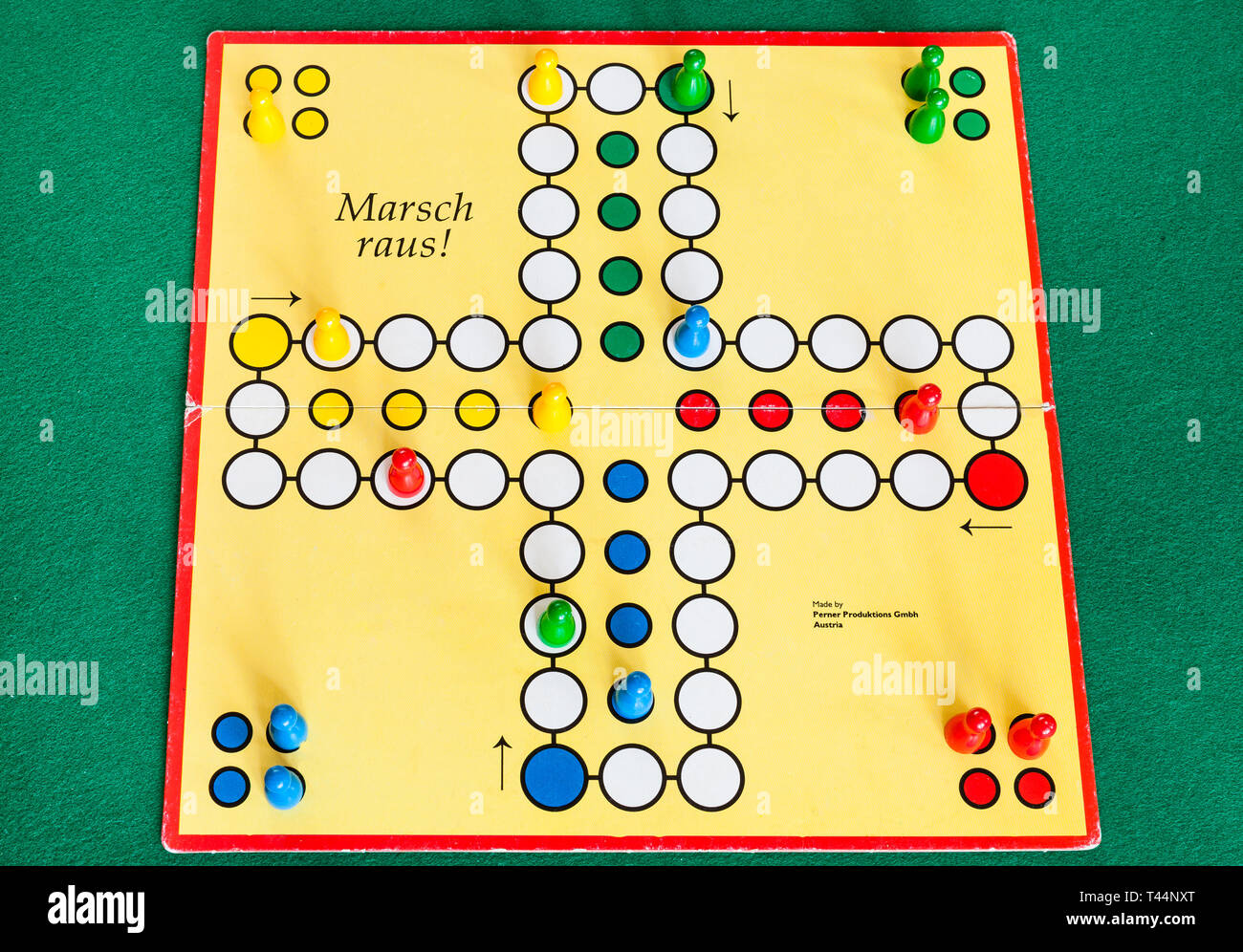 MOSCOW, RUSSIA - APRIL 2, 2019: gameboard of Marsch Raus ! board game on green baize table. This board game is Cross and circle game, an adaptation of - Stock Image