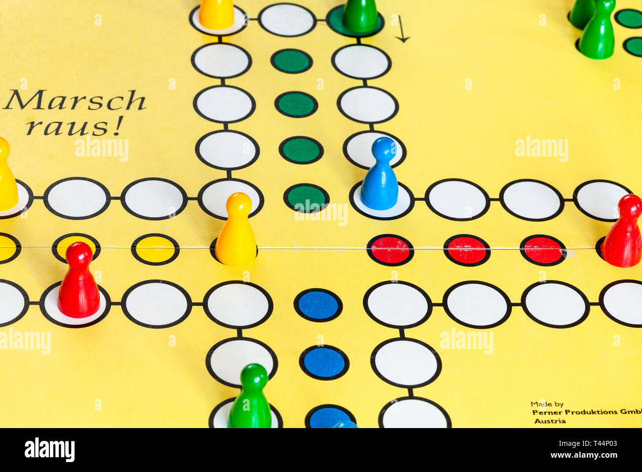 MOSCOW, RUSSIA - APRIL 2, 2019: gameboard of Marsch Raus ! board game close up. This board game is Cross and circle game, an adaptation of the medieva - Stock Image