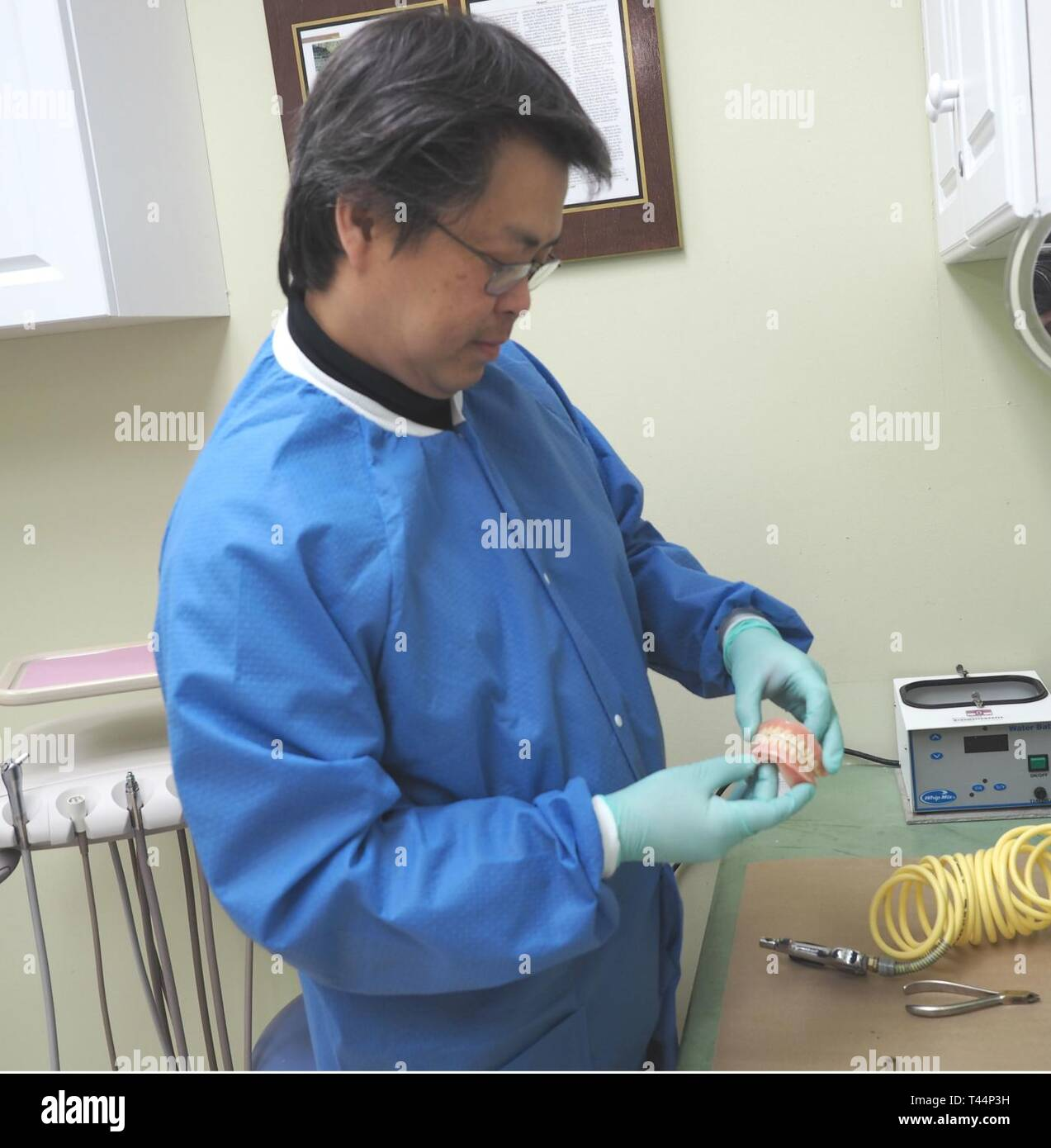 Holding a sample mold, Dr. Dai Phan explains the process of making them for the Veterans who use his service in the Columbia VA Health Care System at the Wm. Jennings Bryan Dorn VA Medical Center in Columbia, S.C. - Stock Image
