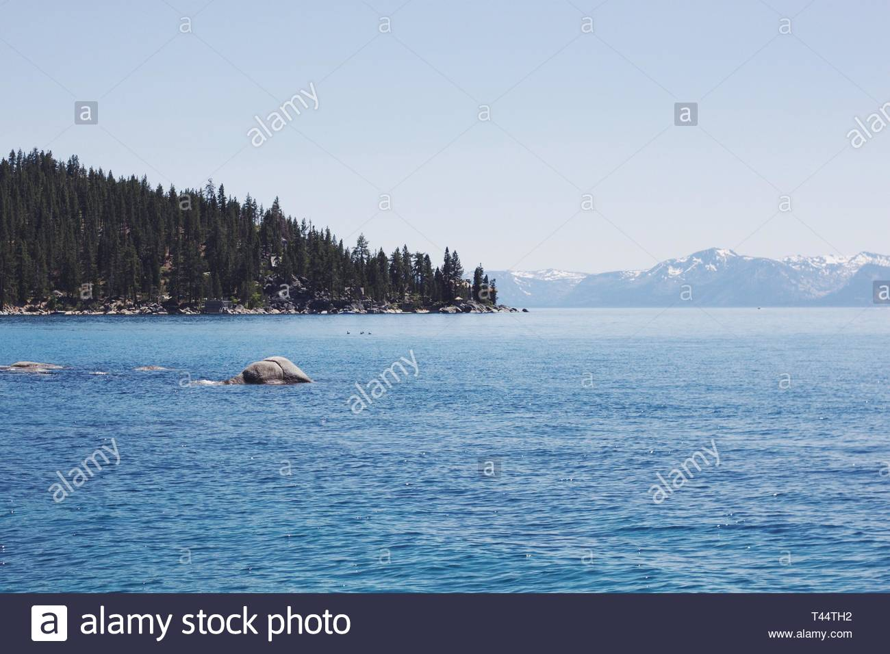 sea with mountains and tr - Stock Image
