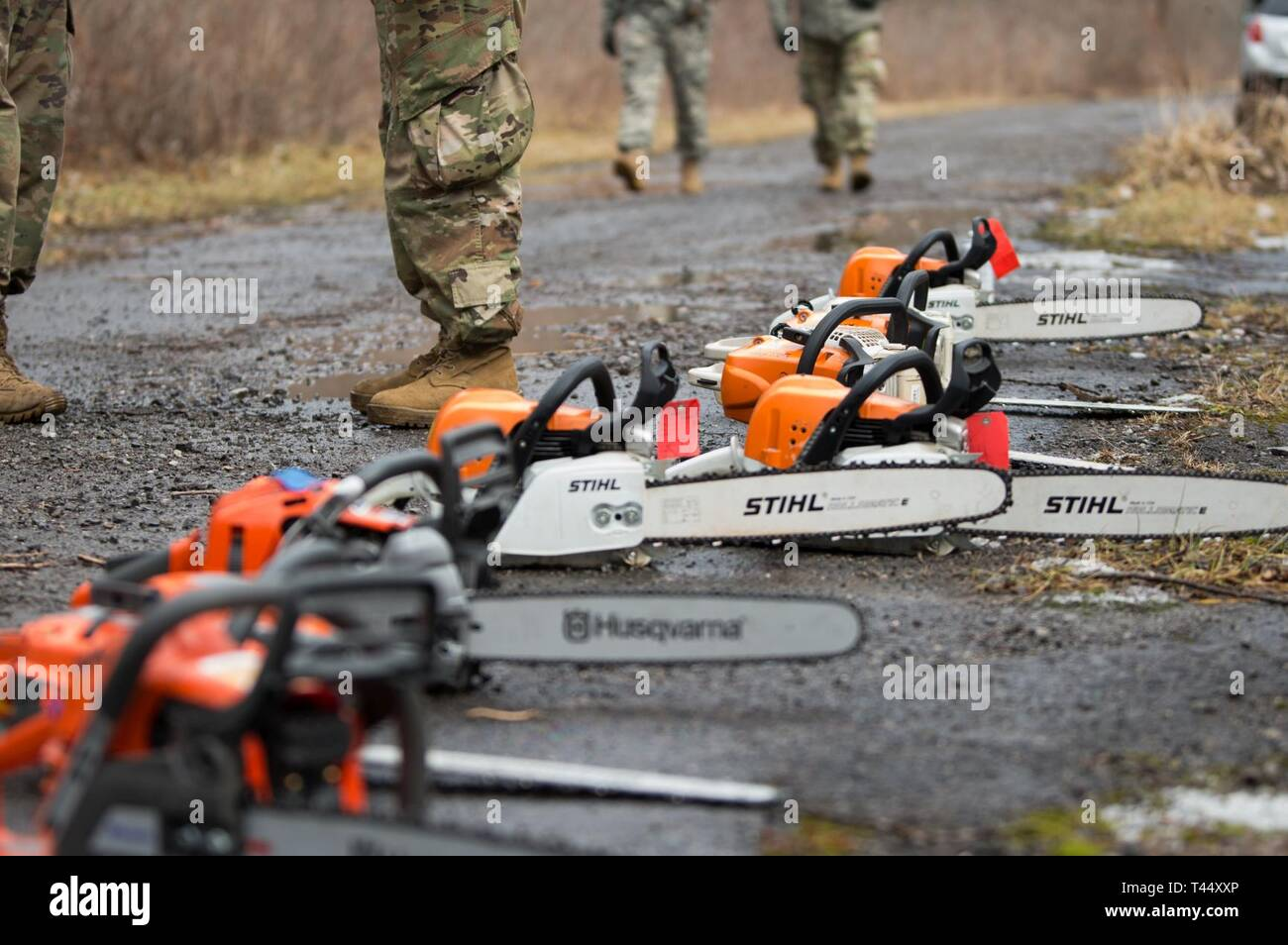 A collection of chainsaws line the road to aid Soldiers in training at Youngstown Local Training Area, Feb. 24, 2019. The training team was composed of New York Army National Guard and New York Guard Soldiers. They trained on how to use the equipment properly and safely. These Soldiers are just a few of more than 250 Soldiers and Airmen that are deployed to Western New York for debris clearing missions in support of Operation February Winter Storm. - Stock Image
