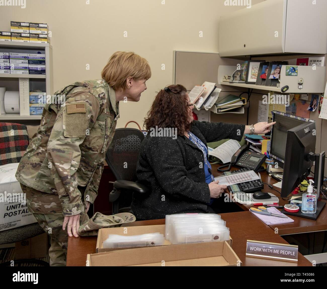 Jennifer Wadhams (right), Armed Forces Medical Examiner System Armed Forces Repository of Specimen Samples for the Identification of Remains supervisor, shows U.S. Air Force Brig. Gen. Sharon Bannister, Defense Health Agency Education and Training deputy assistant director, where her blood stain card resides at AFMES during her visit Feb. 25, 2019. The AFRSSIR is responsible for managing, coordinating and maintaining the collection of DNA blood reference cards for all active duty, reserve, and National Guard service members. This is done when service members first enter the military and is col - Stock Image