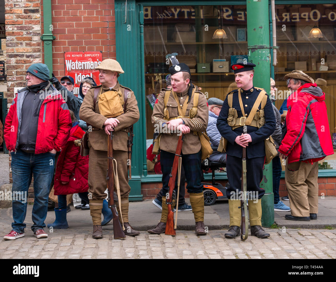 Beamish, Durham County, England, United Kingdom, 13 April 2019. Beamish Steam Day: Men dressed in vintage soldier uniforms from Scots in the Great War living history group, from L to R: Private in Tyneside Scottish, Pipe Major in Argyll & Sutherland Highlanders and Royal Marine Light Infantryman - Stock Photo