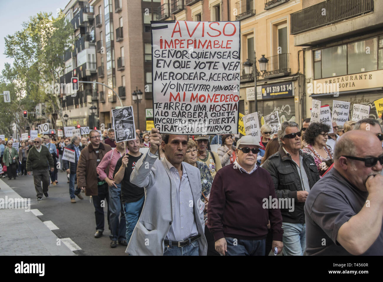 Madrid, Madrid, Spain. 13th Apr, 2019. Protesters are seen holding placards.in defence of pensioners during the demonstration.Demonstration to defend the systemic public pension in Madrid by the CCOO coordination of pensioners that calls on the Government to ensure the presentation in this term of an initiative to repeal the pension reform of 2013, which must be legally validated in the face of elections this month of April 2019, within the framework of broad agreements in the political and social sphere. This initiative is a prior agreement of the social partners (trade unions and employe Stock Photo
