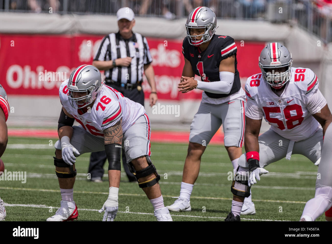 Columbus, Ohio, USA. 13th Apr, 2019. Ohio State Buckeyes Gray quarterback Justin Fields (1) prepares to take his first snap during the Ohio State spring game between the Scarlet and Gray at Ohio Stadium, Columbus, Ohio. Credit: Scott Stuart/ZUMA Wire/Alamy Live News - Stock Image