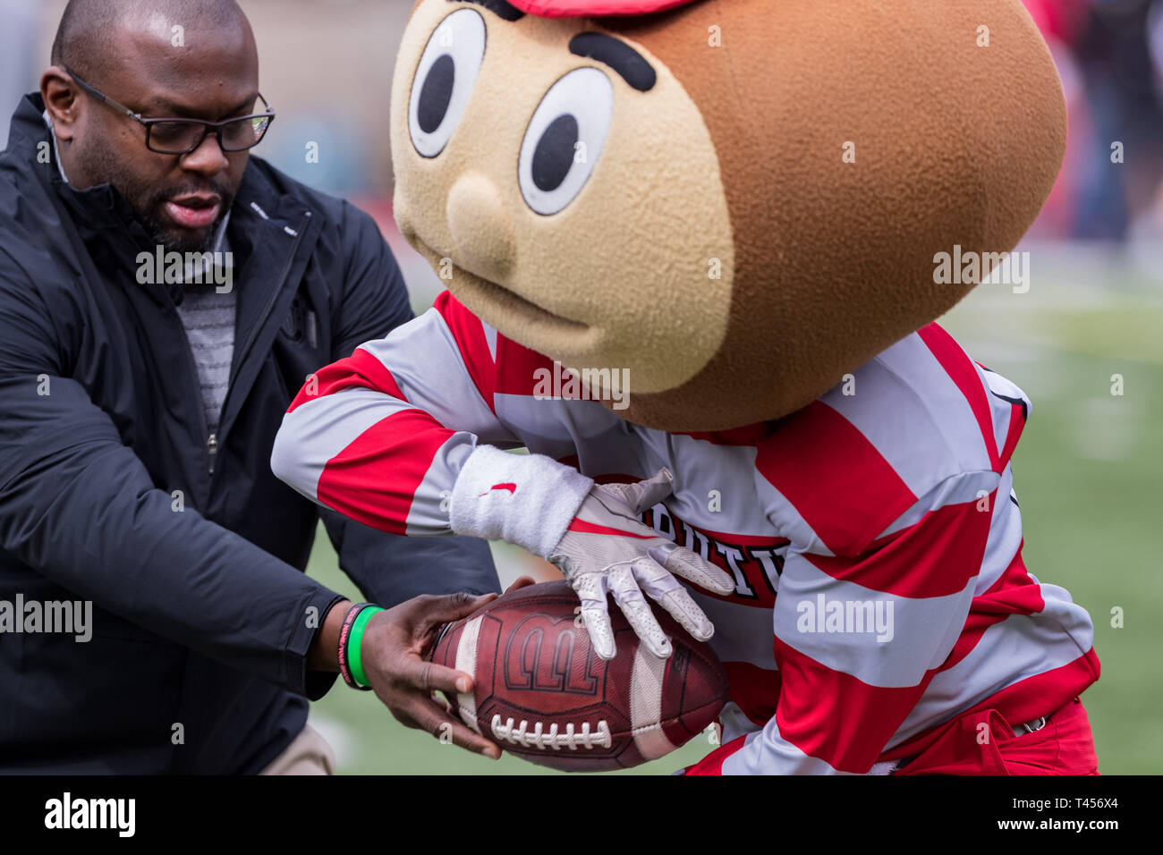Columbus, Ohio, USA. 13th Apr, 2019. Ohio State Buckeyes mascot Brutus takes a handoff during warm up prior to the Ohio State spring game between the Scarlet and Gray at Ohio Stadium, Columbus, Ohio. Credit: Scott Stuart/ZUMA Wire/Alamy Live News - Stock Image