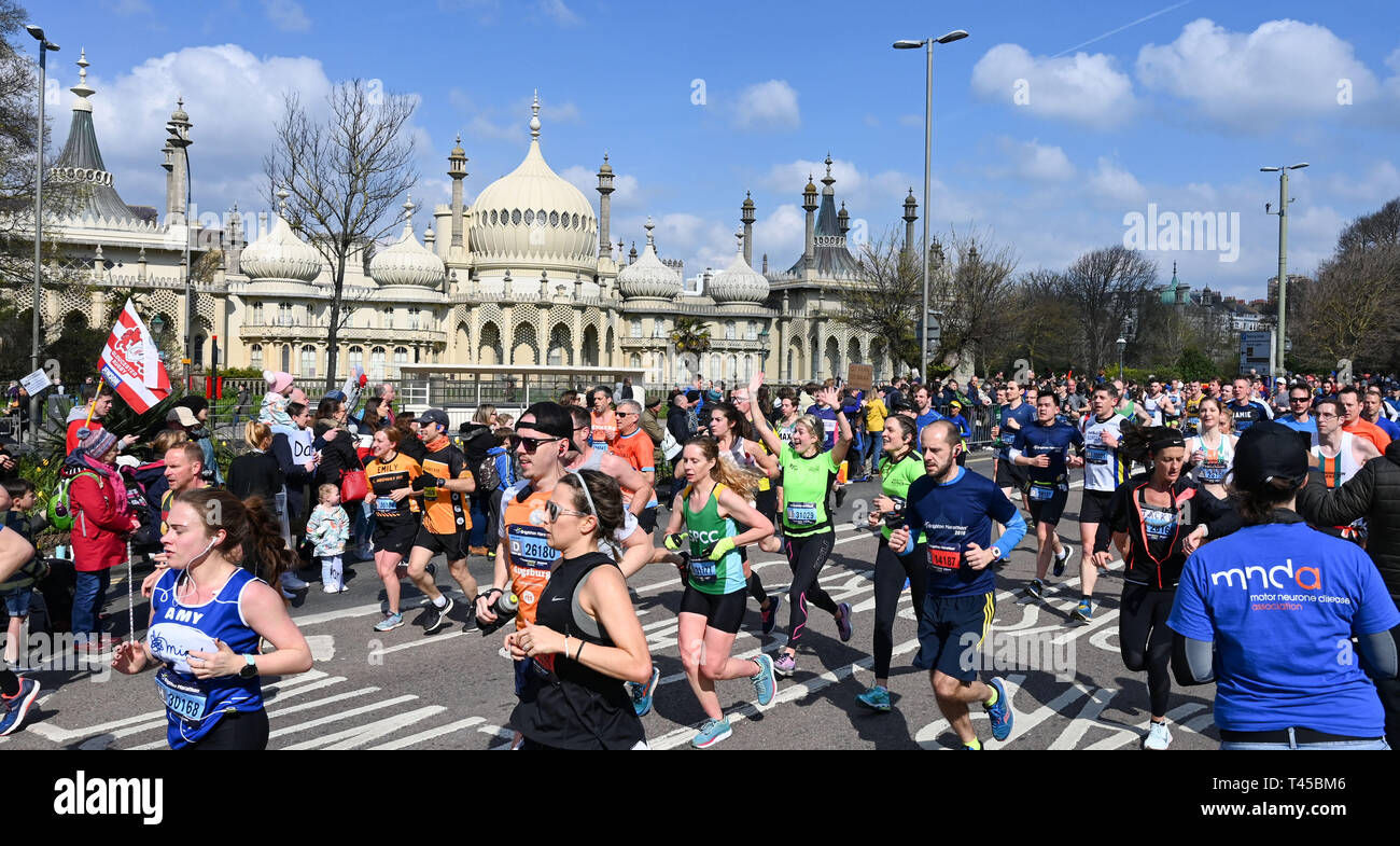 Brighton, Sussex, UK. 14th Apr, 2019. Thousands of runners pass by the Royal Pavilion as they take part in this years Brighton Marathon which is celebrating its 10th anniversary Credit: Simon Dack/Alamy Live News Stock Photo