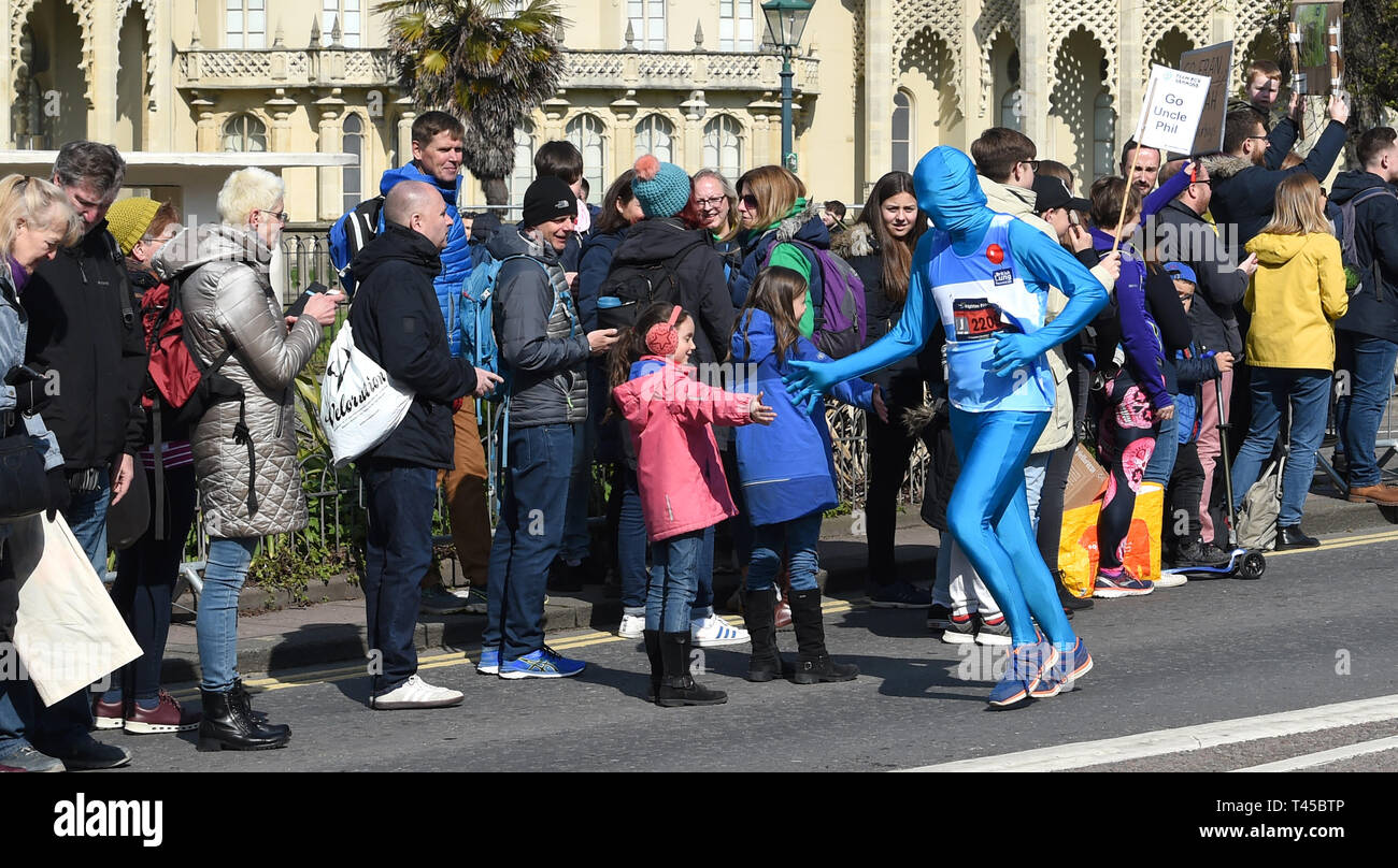 Brighton, Sussex, UK. 14th Apr, 2019. Thousands of runners and spectators take part in this years Brighton Marathon which is celebrating its 10th anniversary Credit: Simon Dack/Alamy Live News Stock Photo