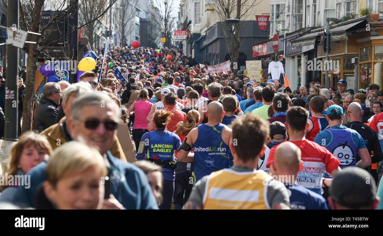 Brighton, Sussex, UK. 14th Apr, 2019. Thousands of runners and spectators in the narrow St James's Street area of Brighton take part in this years Brighton Marathon which is celebrating its 10th anniversary Credit: Simon Dack/Alamy Live News Stock Photo