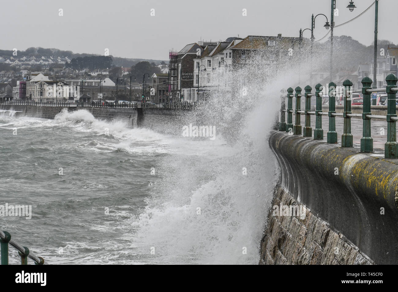 Penzance, Cornwall, UK. 14th April 2019. UK Weather.  The second week of the school holidays started with rain, strong easterly wind and big waves smashing into the seafront at Penzance today. Credit: Simon Maycock/Alamy Live News Stock Photo