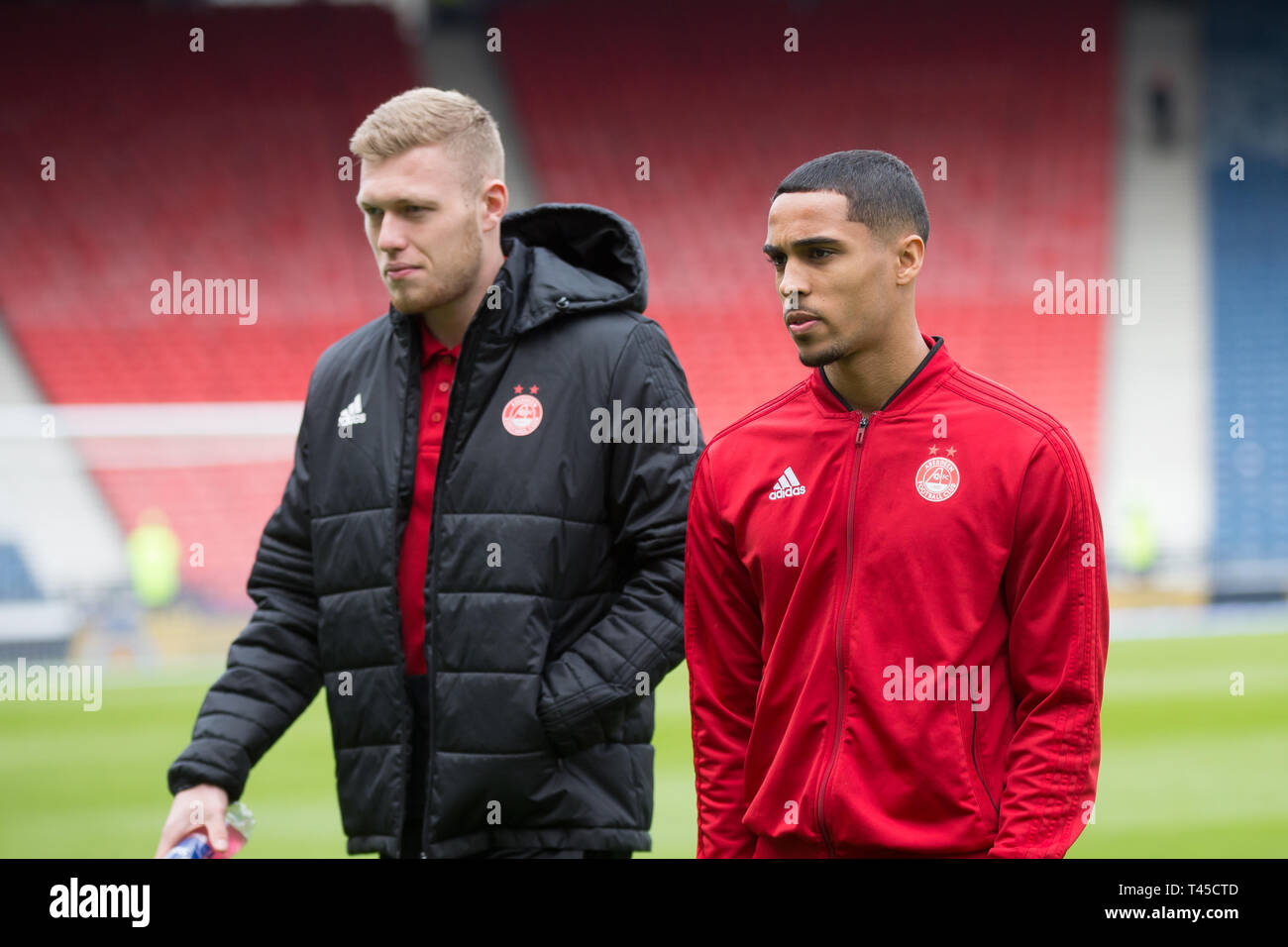 Hampden Park, Glasgow, UK. 14th Apr, 2019. Scottish Cup football, semi final, Aberdeen versus Celtic; Sam Cosgrove and Max Lowe of Aberdeen inspects the pitch before the match Credit: Action Plus Sports/Alamy Live News - Stock Image