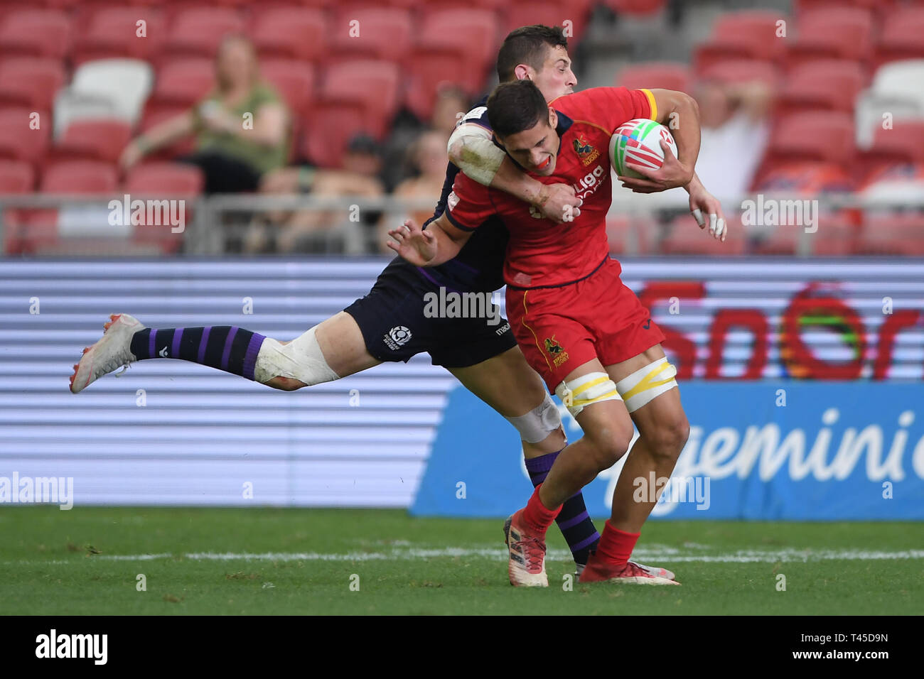 Singapore. 14th Apr, 2019. (L-F) Robbie Fergusson (SCL) - Tobias Sainz-Trapaga (ESP), APR 14, 2019 - in action during Challenge Trophy QF1 HSBC Singapore Rugby 7s 2019 Credit: Aflo Co. Ltd./Alamy Live News - Stock Image