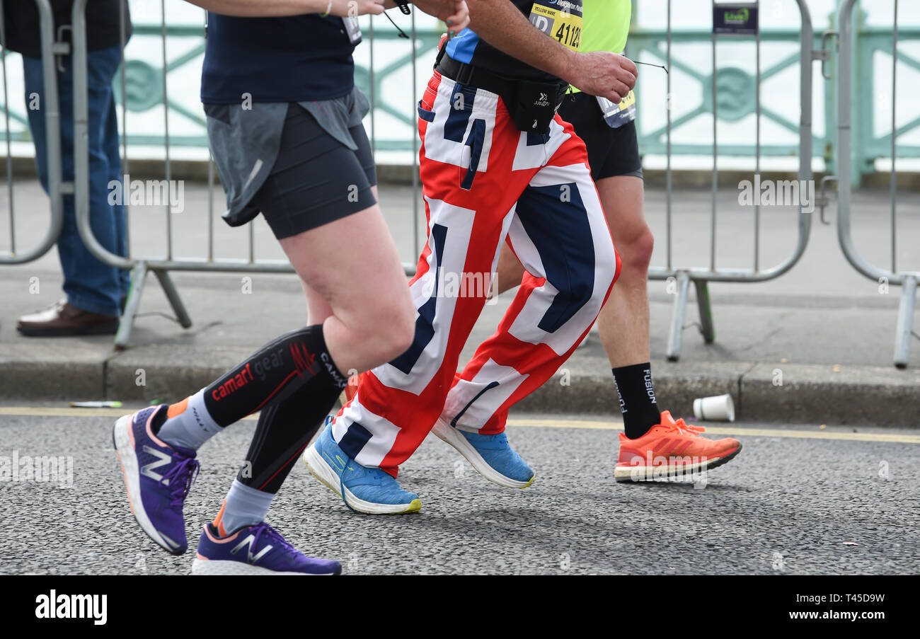 Brighton UK 14th April 2019 -   Thousands of runners some in fancy dress take part in this years Brighton Marathon which is celebrating its 10th anniversary Credit: Simon Dack/Alamy Live News Stock Photo