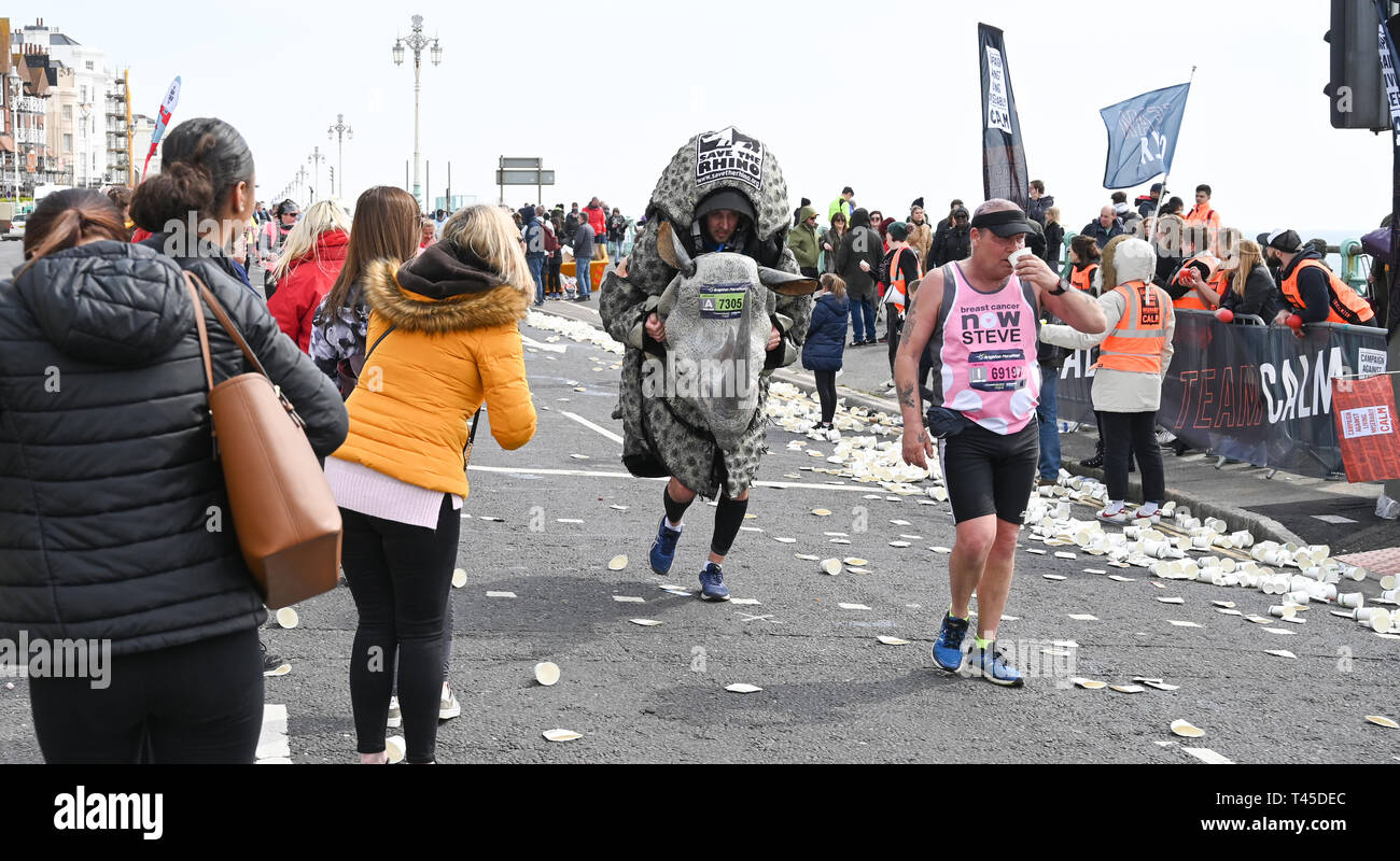 Brighton UK 14th April 2019 -   A Save the Rhino campaigner with Thousands of runners some in fancy dress take part in this years Brighton Marathon which is celebrating its 10th anniversary Credit: Simon Dack/Alamy Live News Stock Photo