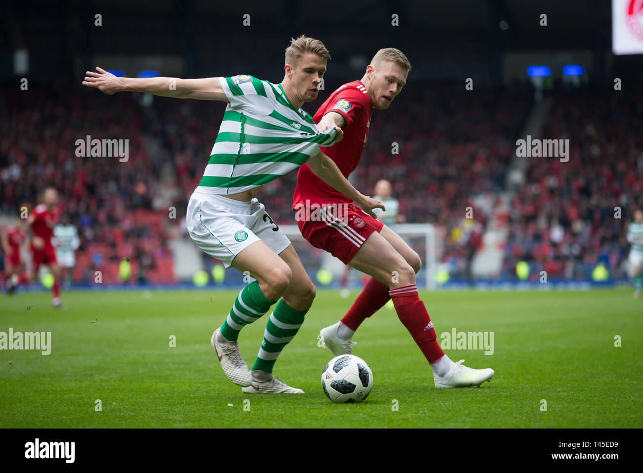 Hampden Park, Glasgow, UK. 14th Apr, 2019. Scottish Cup football, semi final, Aberdeen versus Celtic; Kristoffer Ajer of Celtic challenges for the ball with Sam Cosgrove of Aberdeen Credit: Action Plus Sports/Alamy Live News - Stock Image