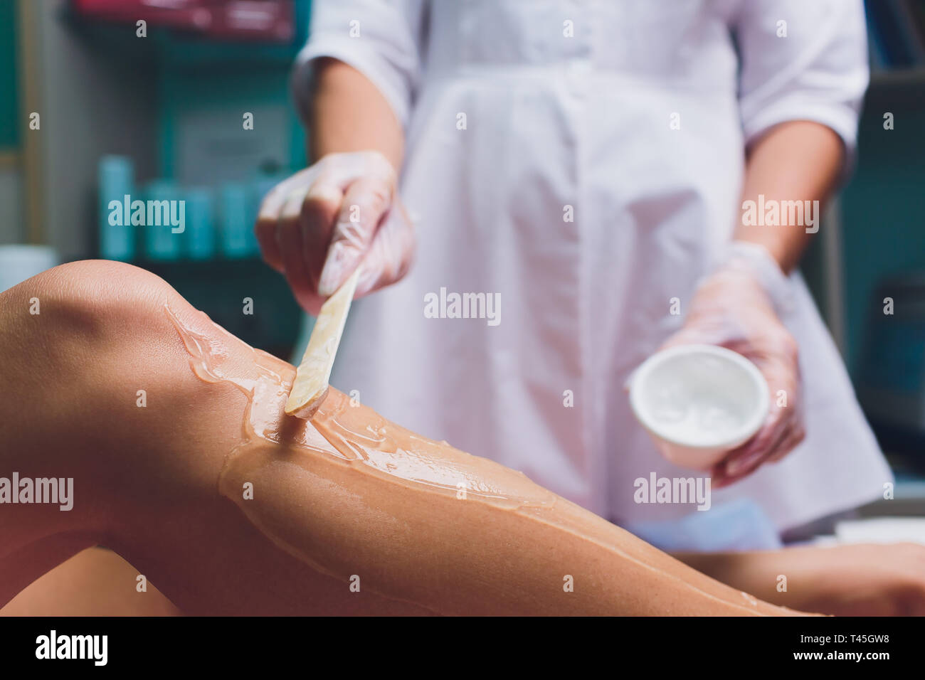Applying a contact gel before the procedure of laser hair