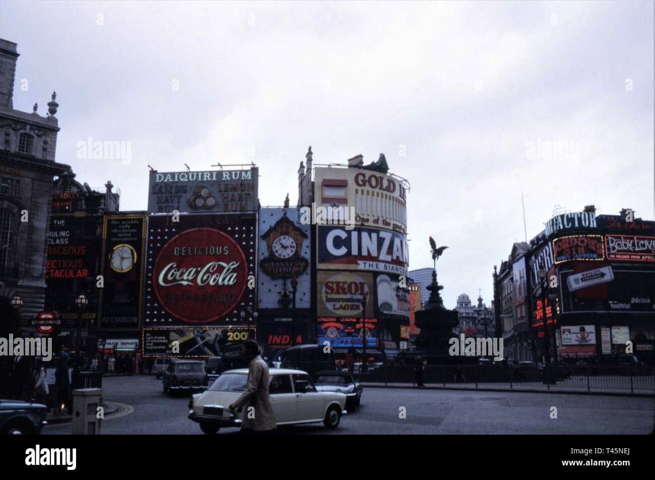 PICCADILLY CIRCUS LONDON West End Swinging London early 1969 Eros statue in original position Illuminated Signs Colour Photo - Stock Image