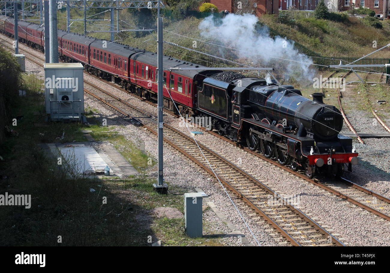 The Pennine Blackpool Express special train approaching Poulton-le-Fylde behind Jubilee class preserved steam loco 45690 Leander on 13th April 2019. - Stock Image