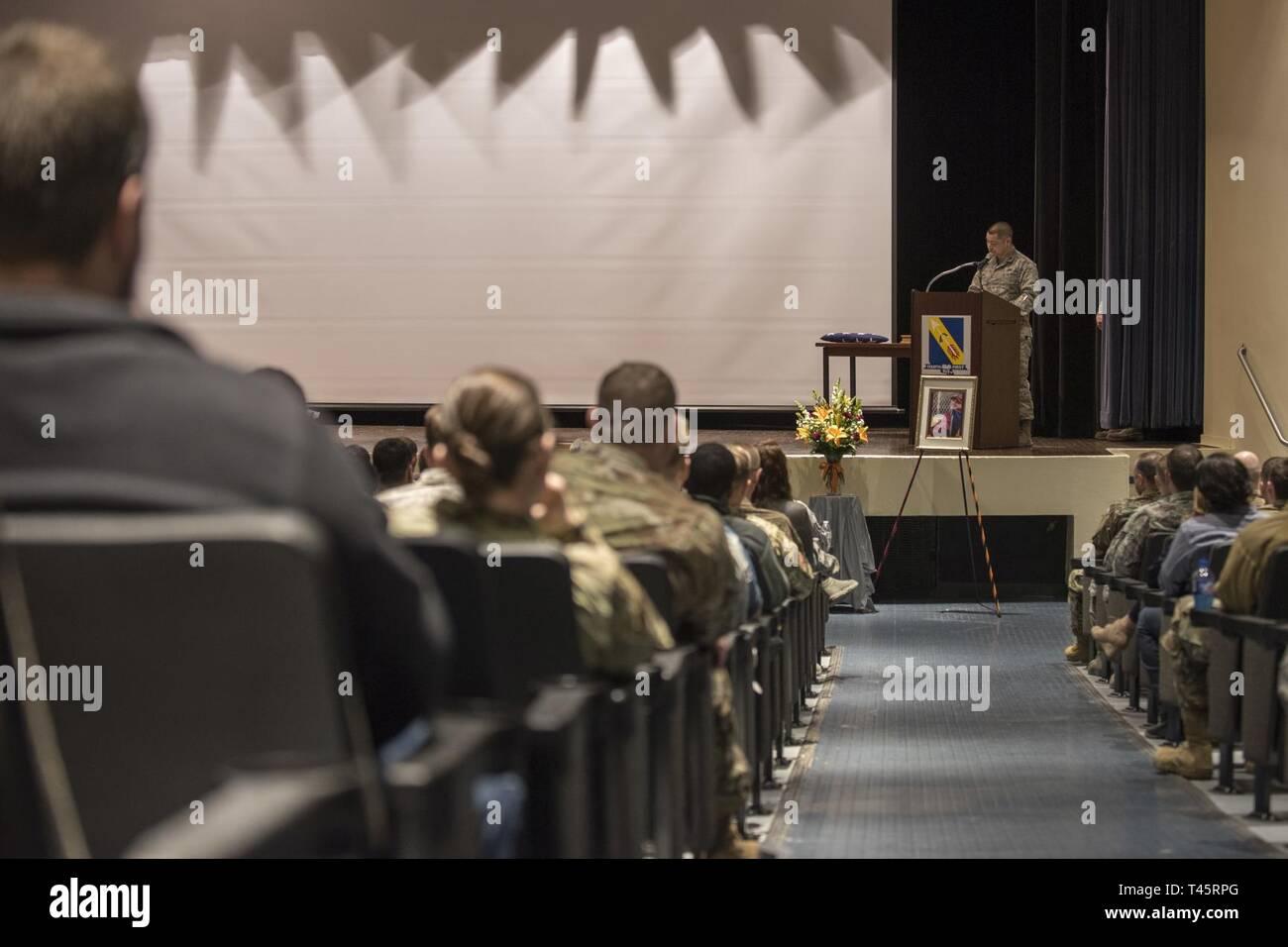 Maj  Timothy Wu, 4th Equipment Maintenance Squadron commander, lists