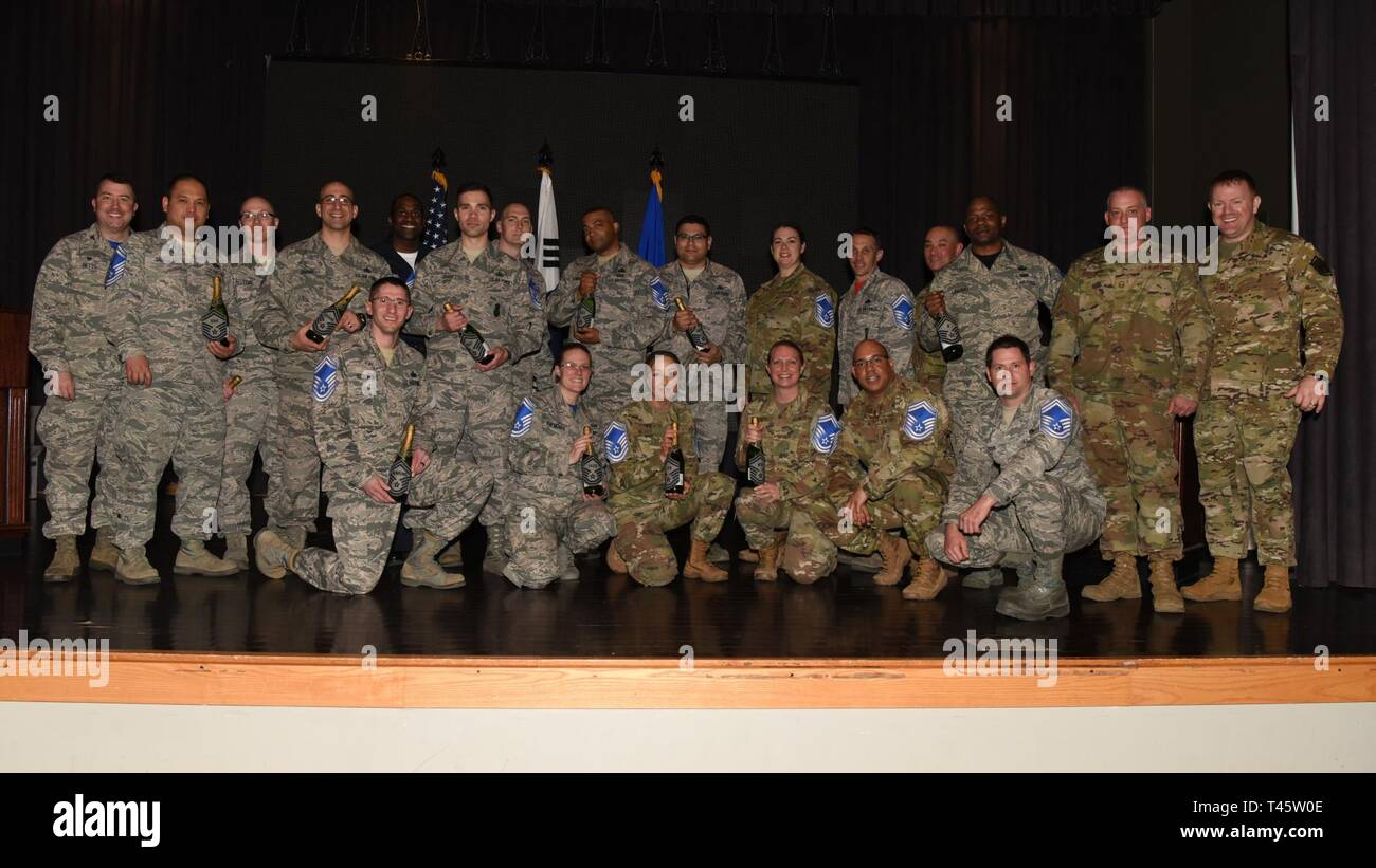 Team Osan's newest senior master sergeant selects pose for a