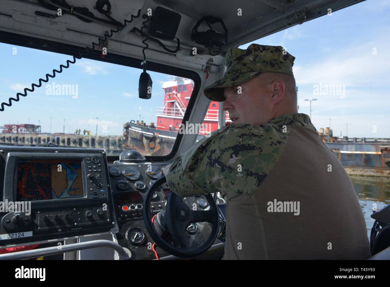 Coast Guardsmen from Port Security Unit 309 waterside division aboard a 32-foot Transportable Port Security Boat acts as a safety observer during the real-time Field Training Exercise (FTX) in the Port of Tampa Bay on Monday, March 11, 2019. PSU 301, stationed in Cape Cod, Mass, traveled to Tampa Bay, FL to conduct this very important FTX due to unfavorable weather conditions in the Northeast. U.S. Coast Guard Stock Photo