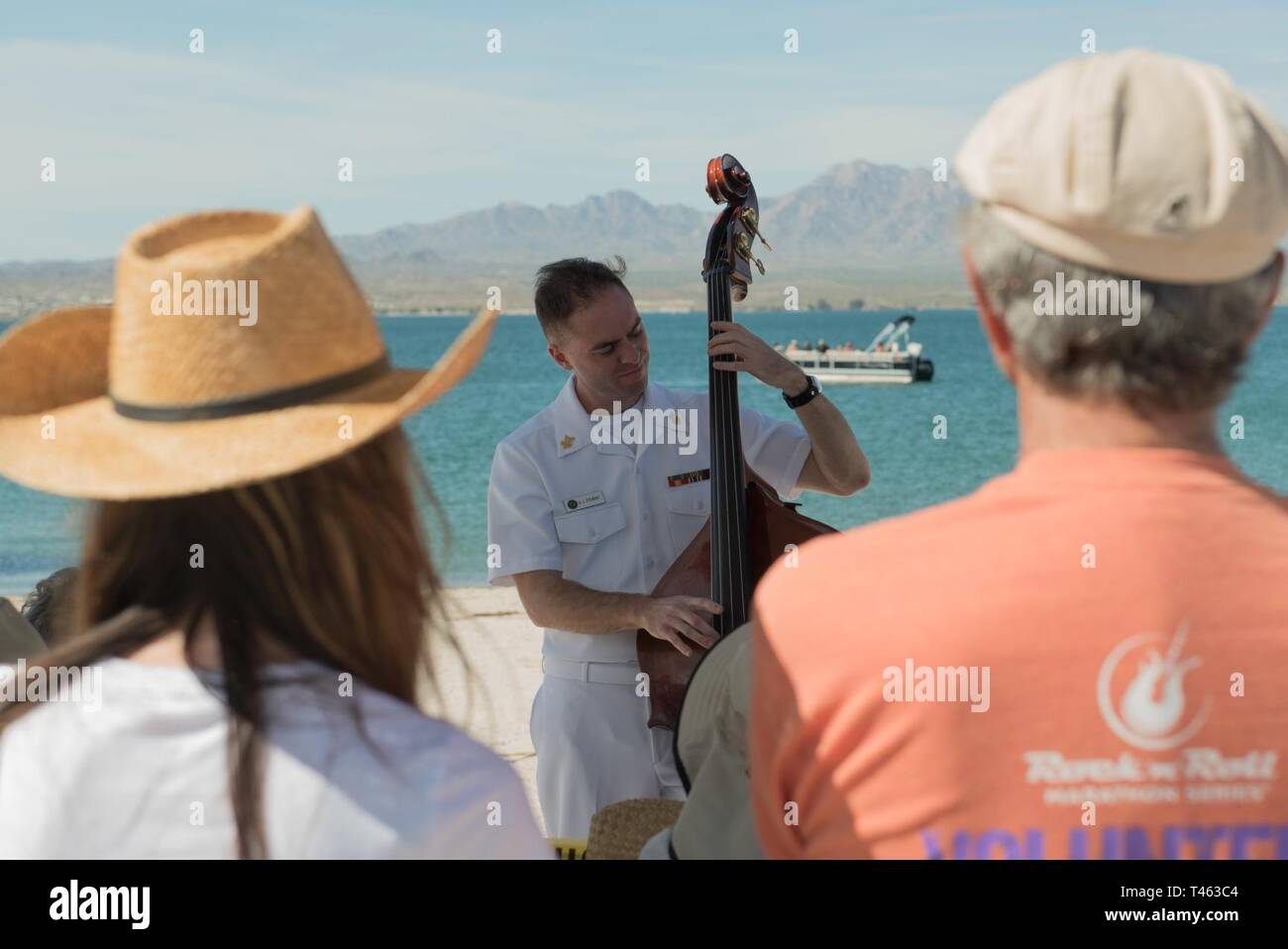 "LAKE HAVASU CITY,  Arizona (March 1, 2019)  Musician 1st Class Danny Stuart conducts an upright bass workshop at the Lake Havasu ""Bluegrass on the Beach"" bluegrass festival. The Navy Band performs all across the country providing an opportunity for communities to connect with Sailors and going where ships can't go to forge strong and capable partnerships for a stronger America. Stock Photo"
